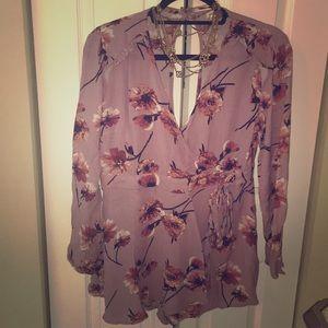 Lilac floral skirted v neck long sleeve romper